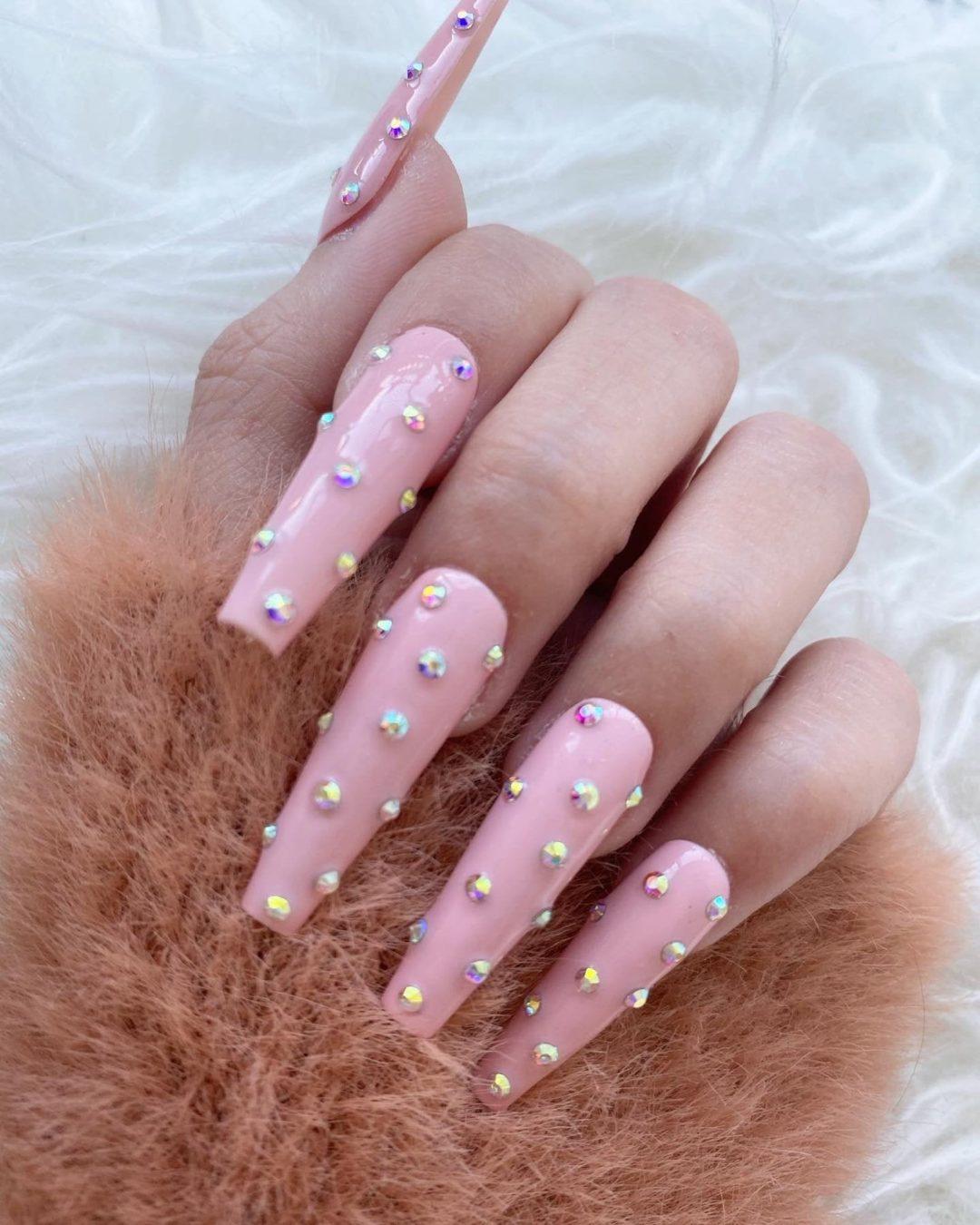 Soft pink rhinestone nails