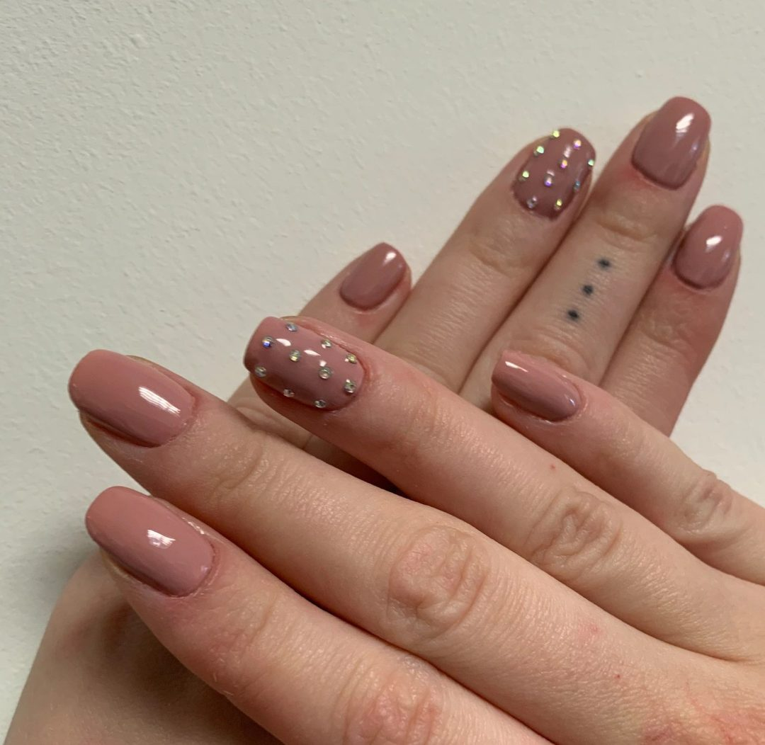 Nude pink nails with rhinestones for New Years Eve nails
