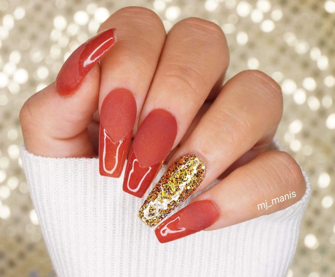 Burnt orange nails and gold glitter
