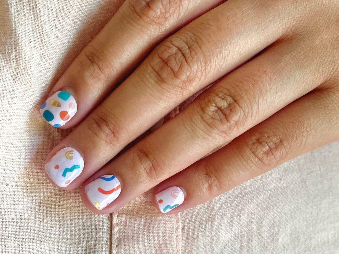 Cartoonish confetti birthday nails