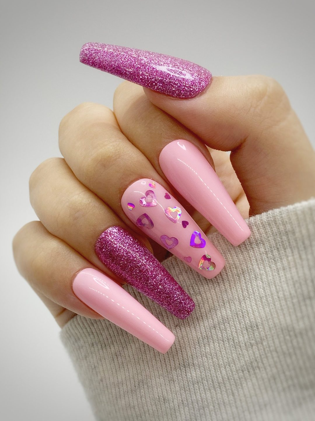 Pink heart nails with pink glitter