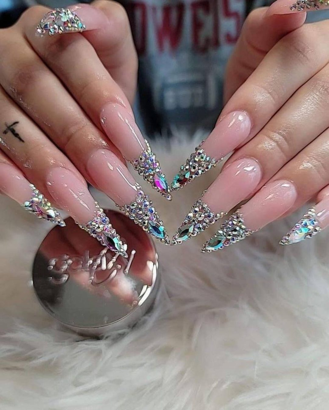 Nude nails with rhinestone tips