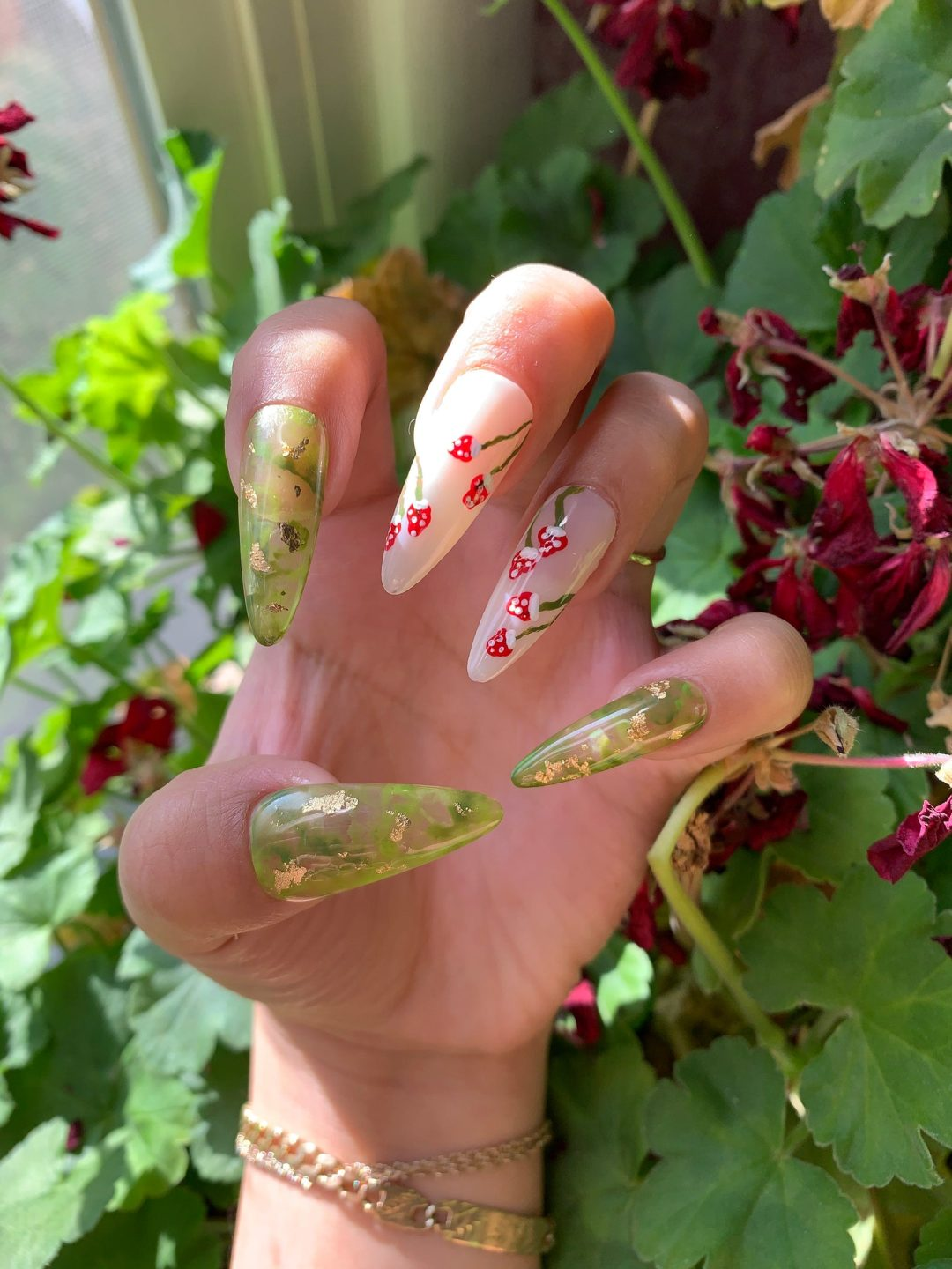 Mint green marble nails with mushrooms