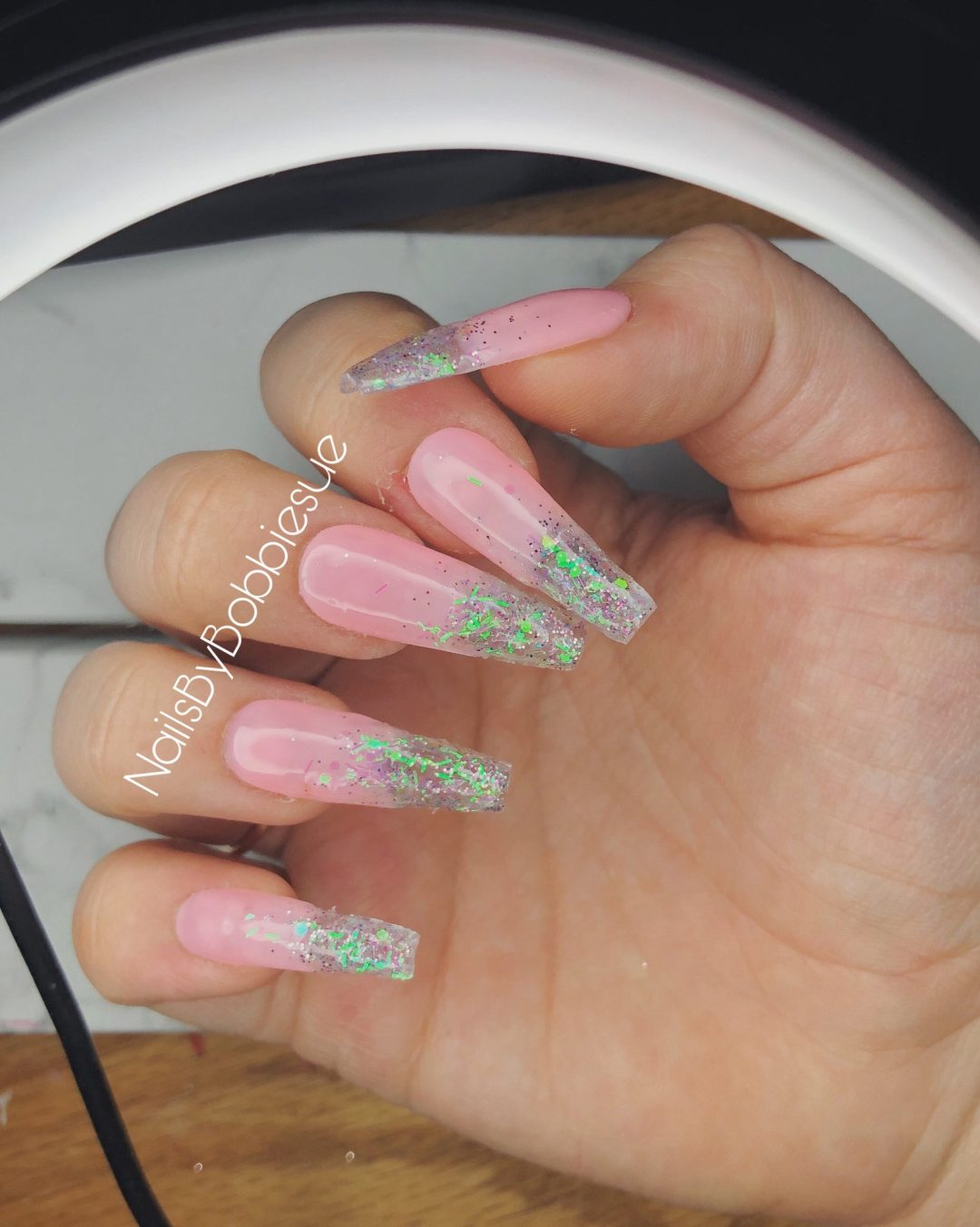 Pink and glitter ombre nails