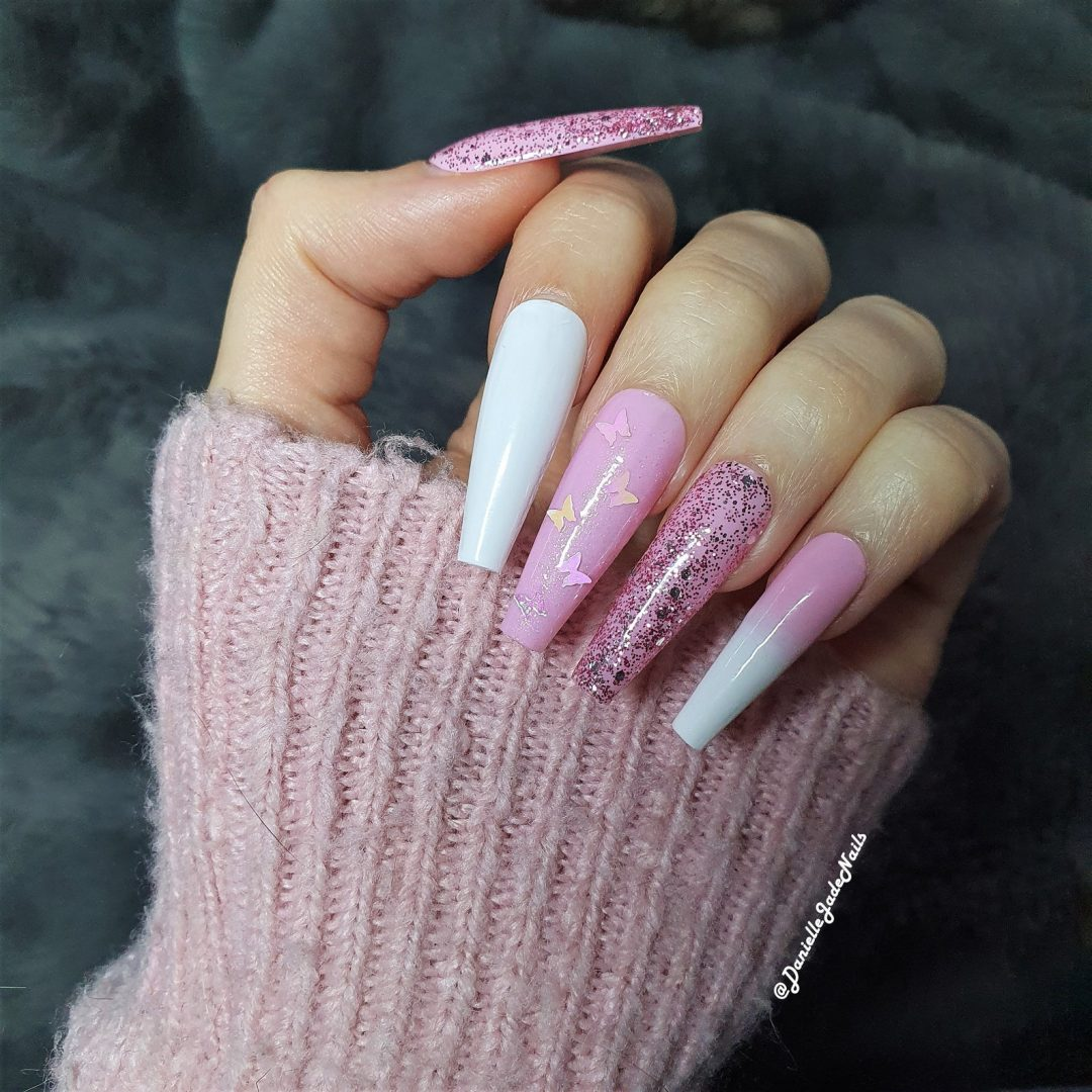 Pink and white nails with glitter and butterflies