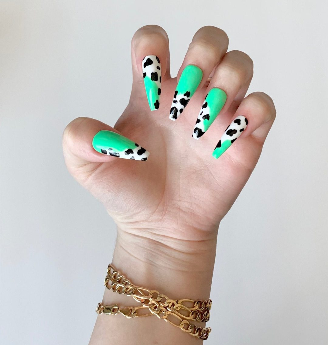 Mint green nails with cow print