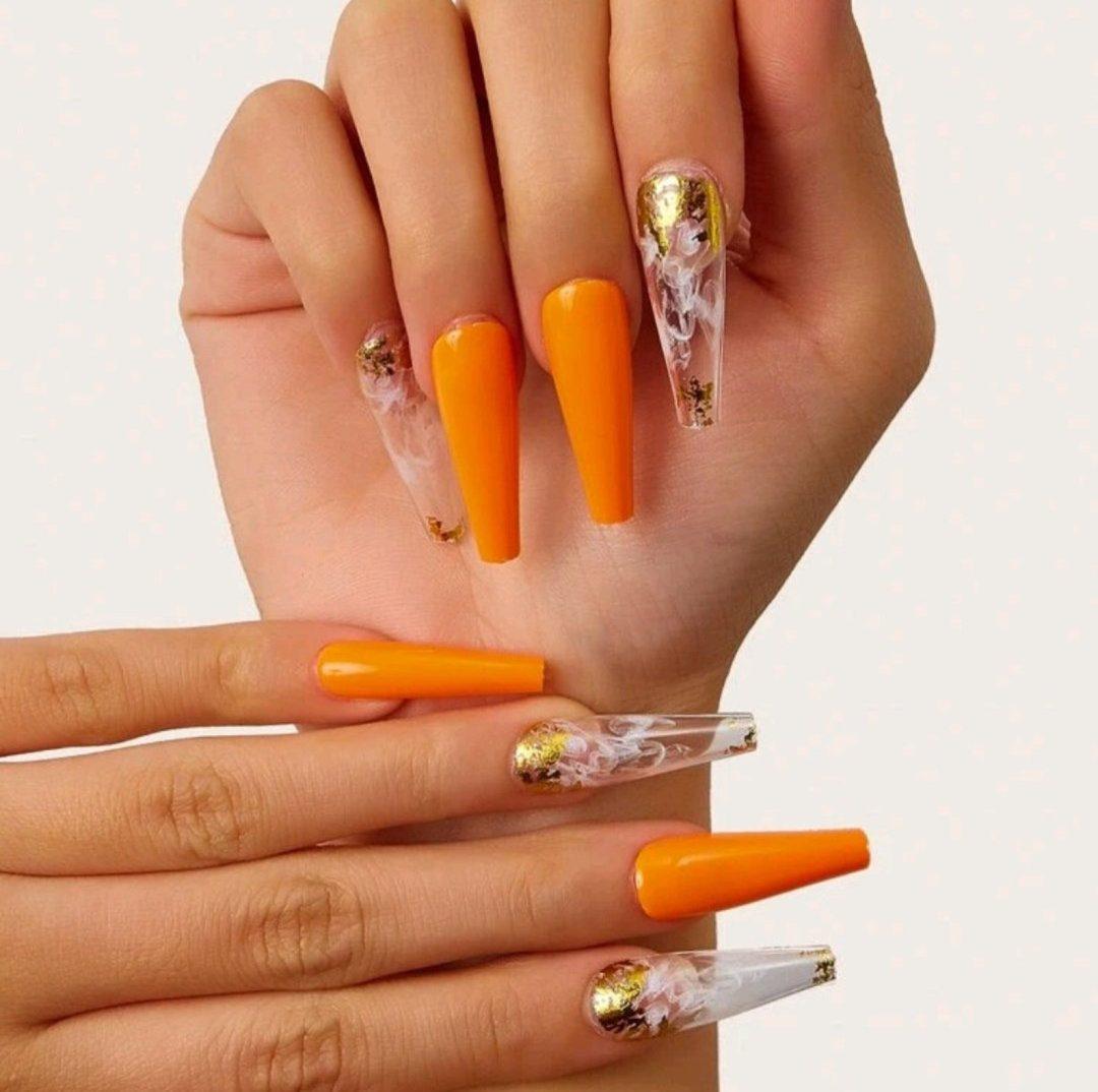 Burnt orange nails with transparent smoke details