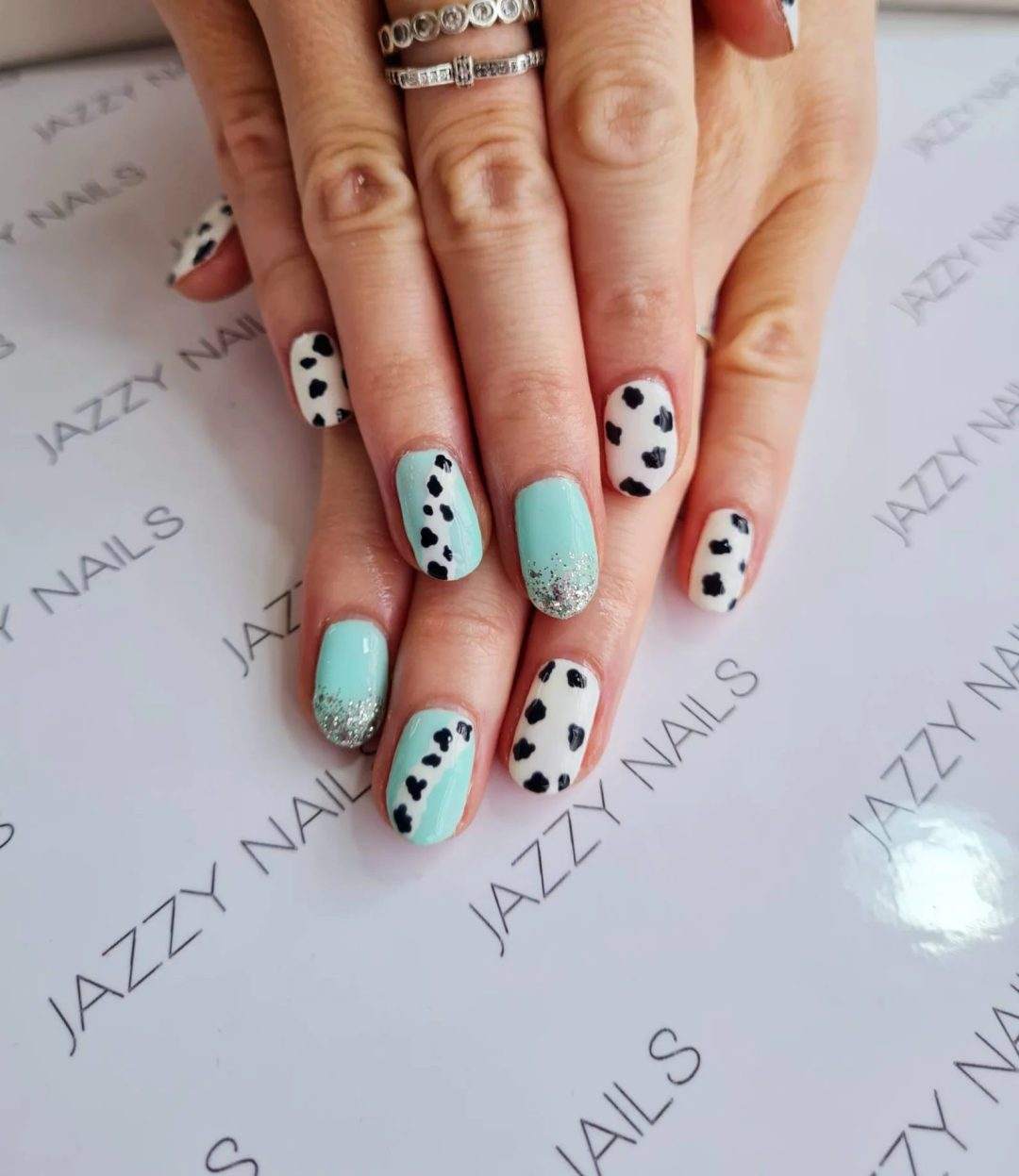 Mint green nails with glitter and cow print