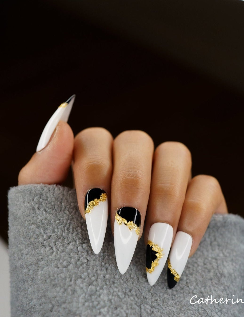 Black and white nails with gold specks