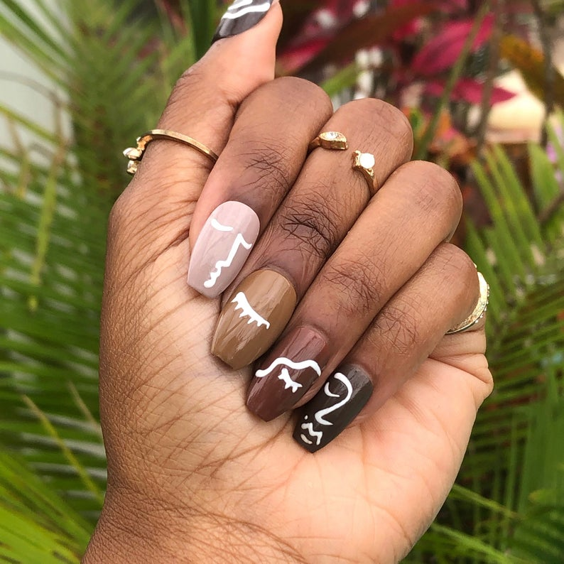 Gradient brown nails with abstract face details