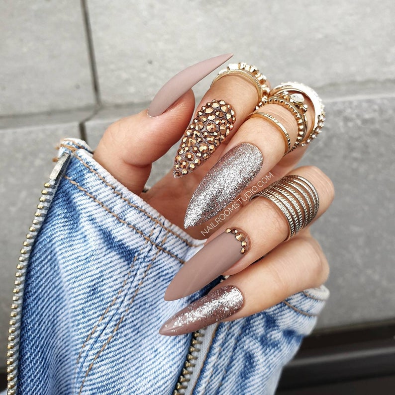 Matte brown nails with rhinestones and glitter
