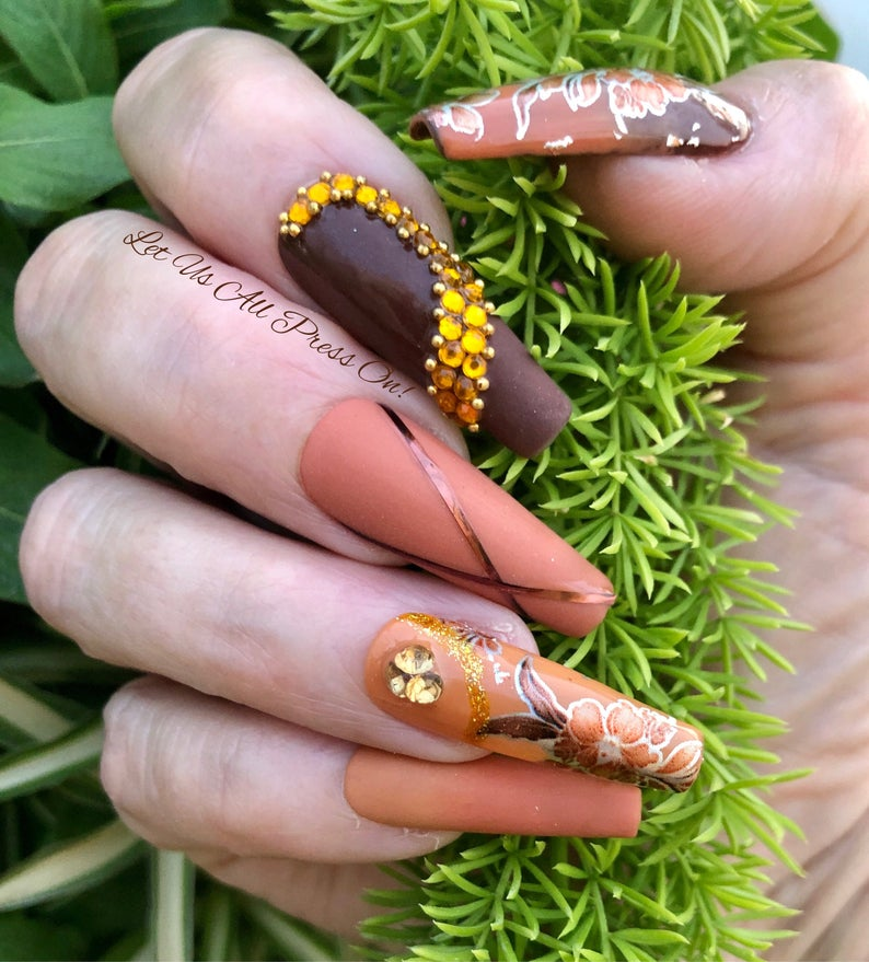 Brown nails with different shades and stickers