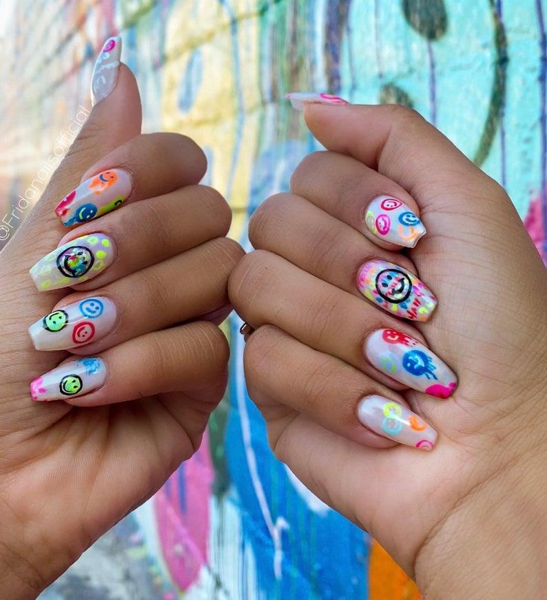 Tie dye graffiti smiley face nails