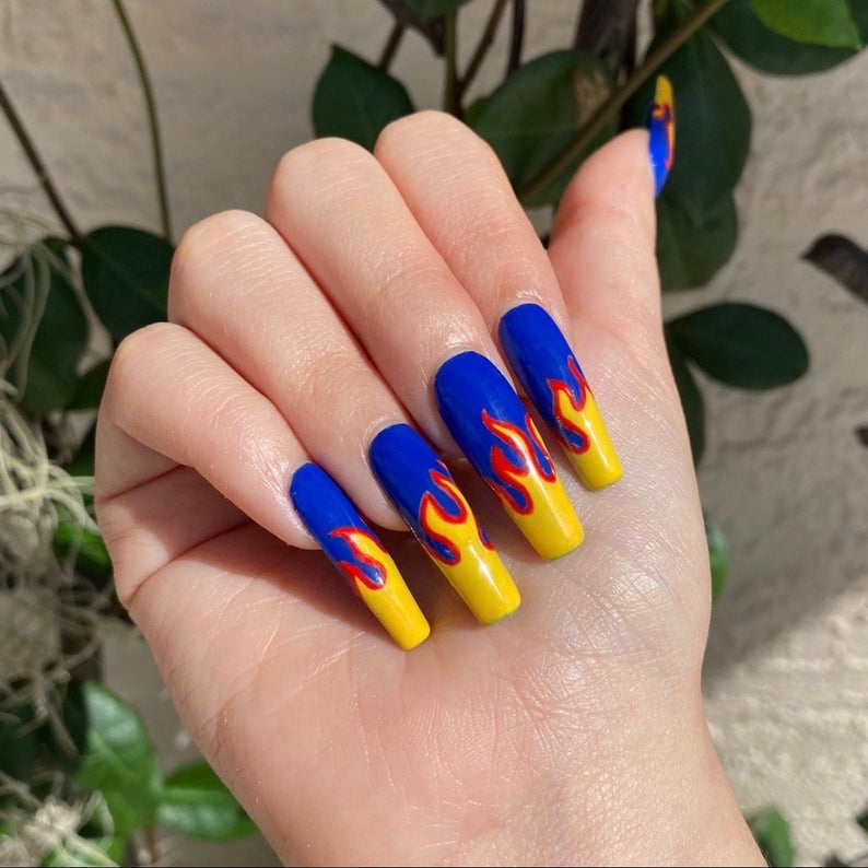 Blue and yellow flame nails with red outline