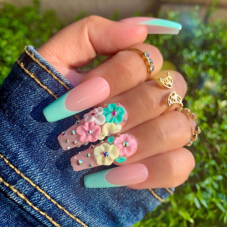 Nude polish and mint green tips with flowers and rhinestones
