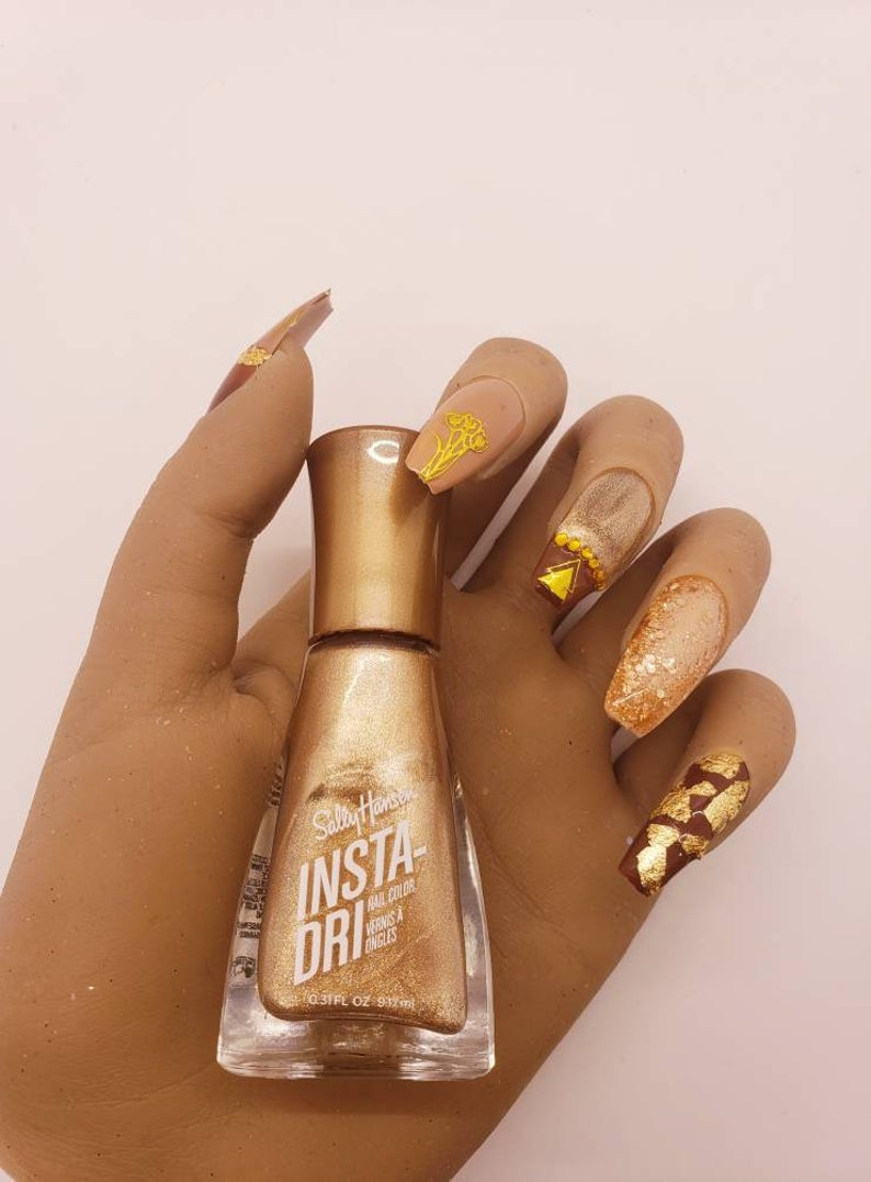 Brown nails with glitter and gold specks