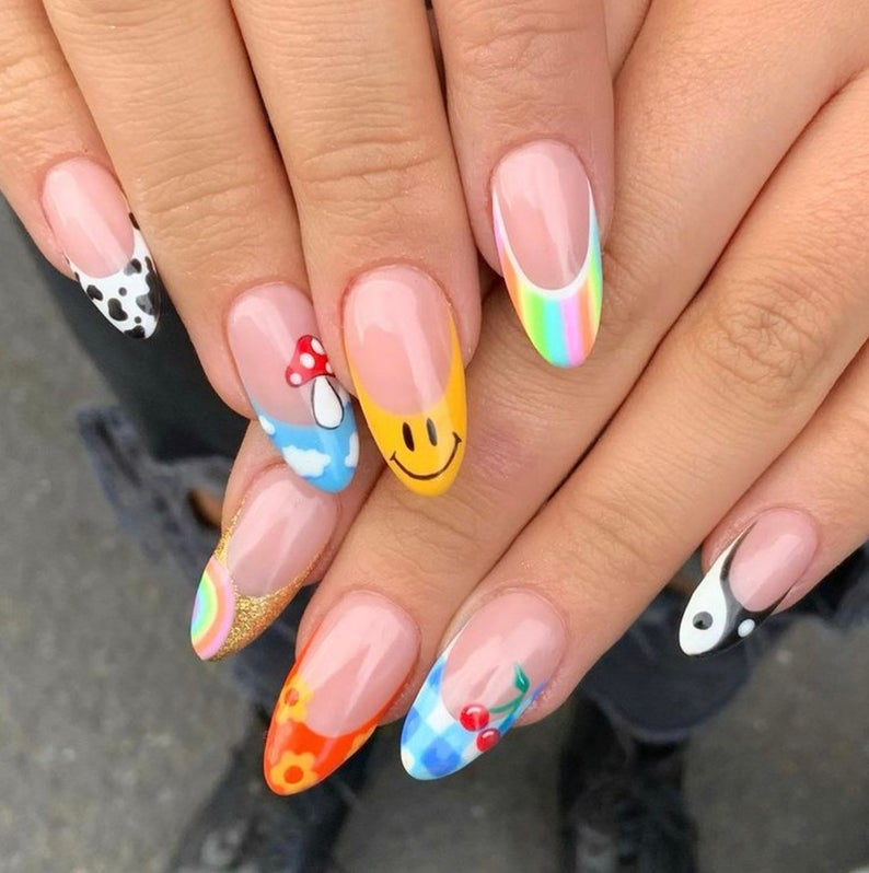 Y2k smiley face nails with different designs on tips
