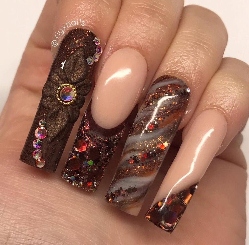 Brown nails with rhinestones and glitter