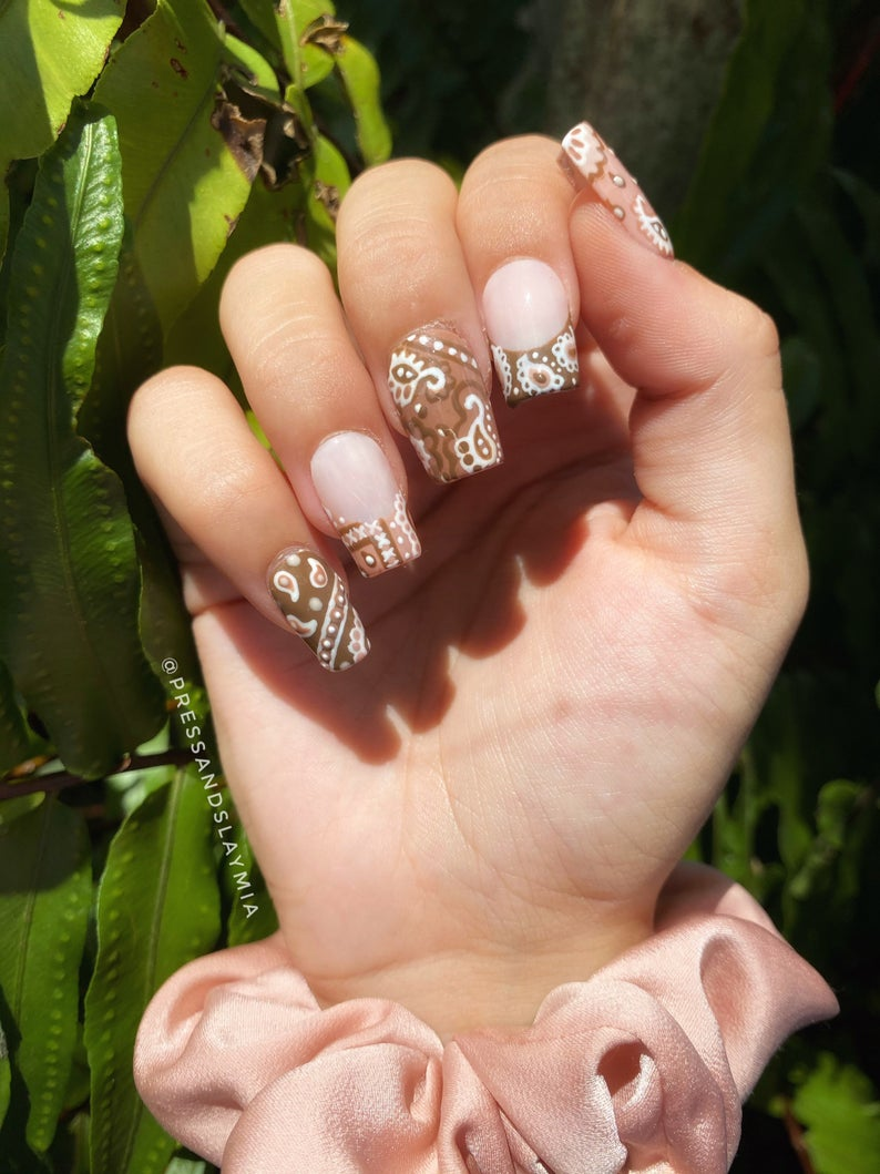 Abstract brown French tip nails
