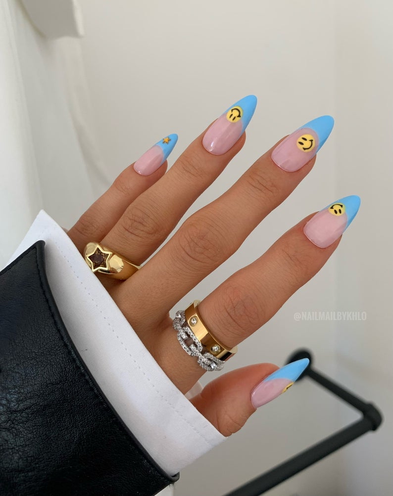Blue tips and smiley face nails