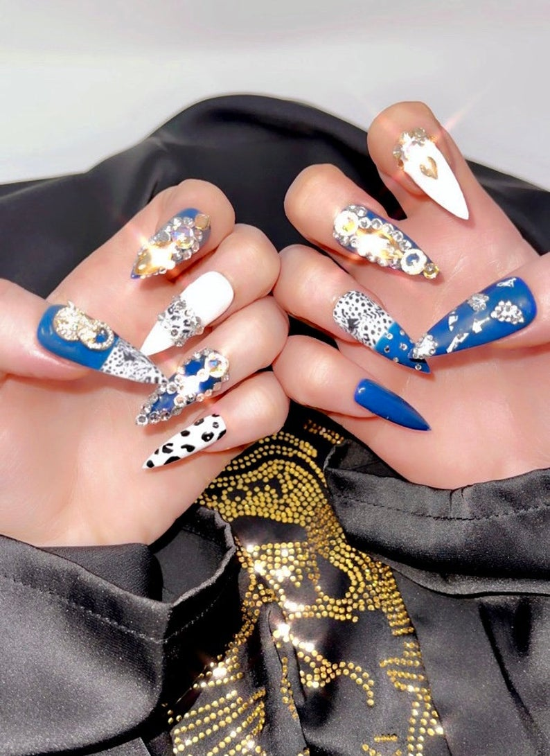 Blue and white nails with rhinestones and cow print