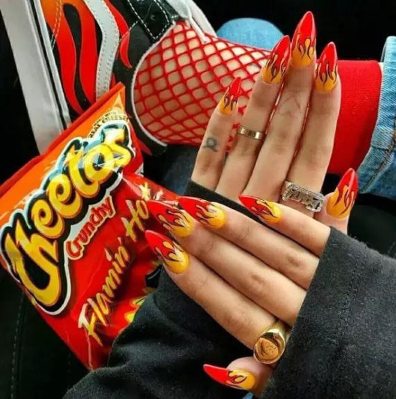 Cheetos-inspired red and yellow flame nails