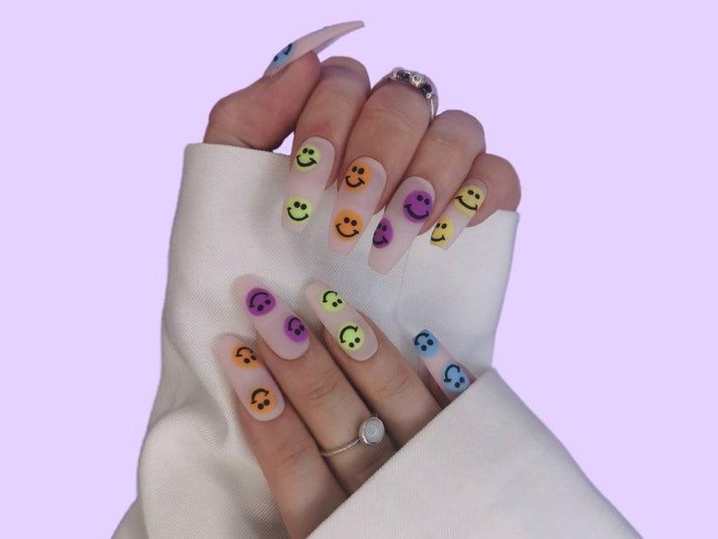 Transparent matte multicolor smiley face nails