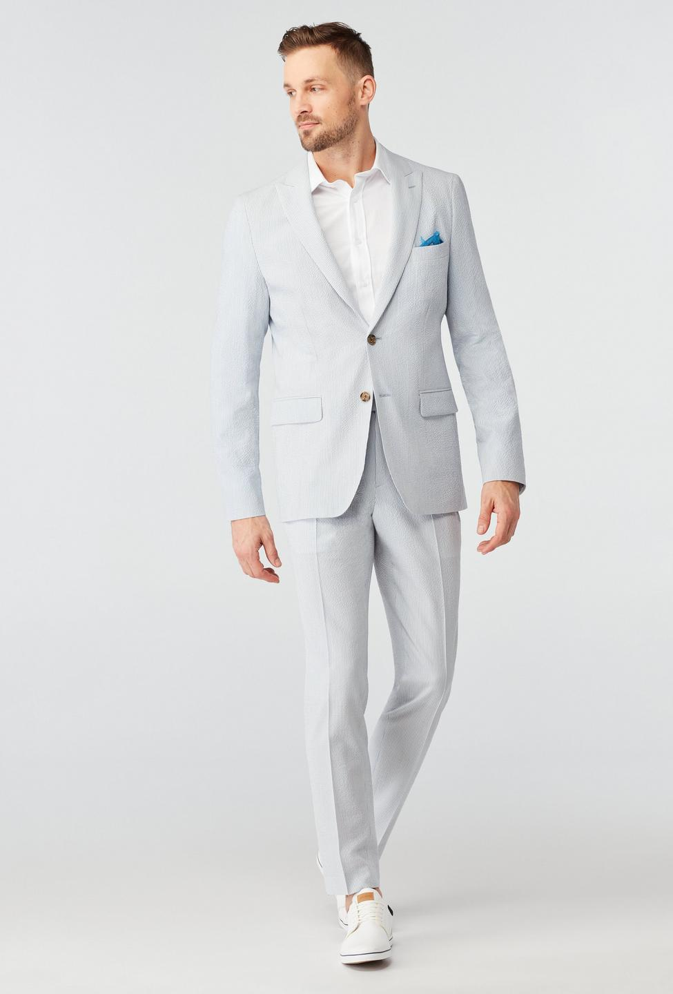 Mens beach wedding guest outfit idea with light grey suit