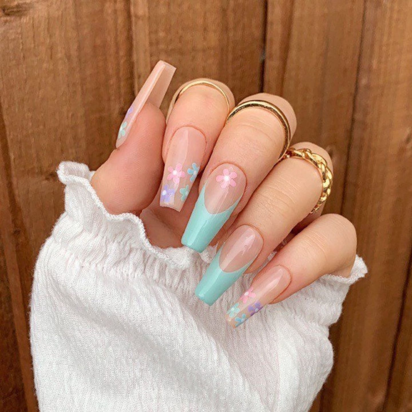 Cute mint green French tip nails with flower nail art