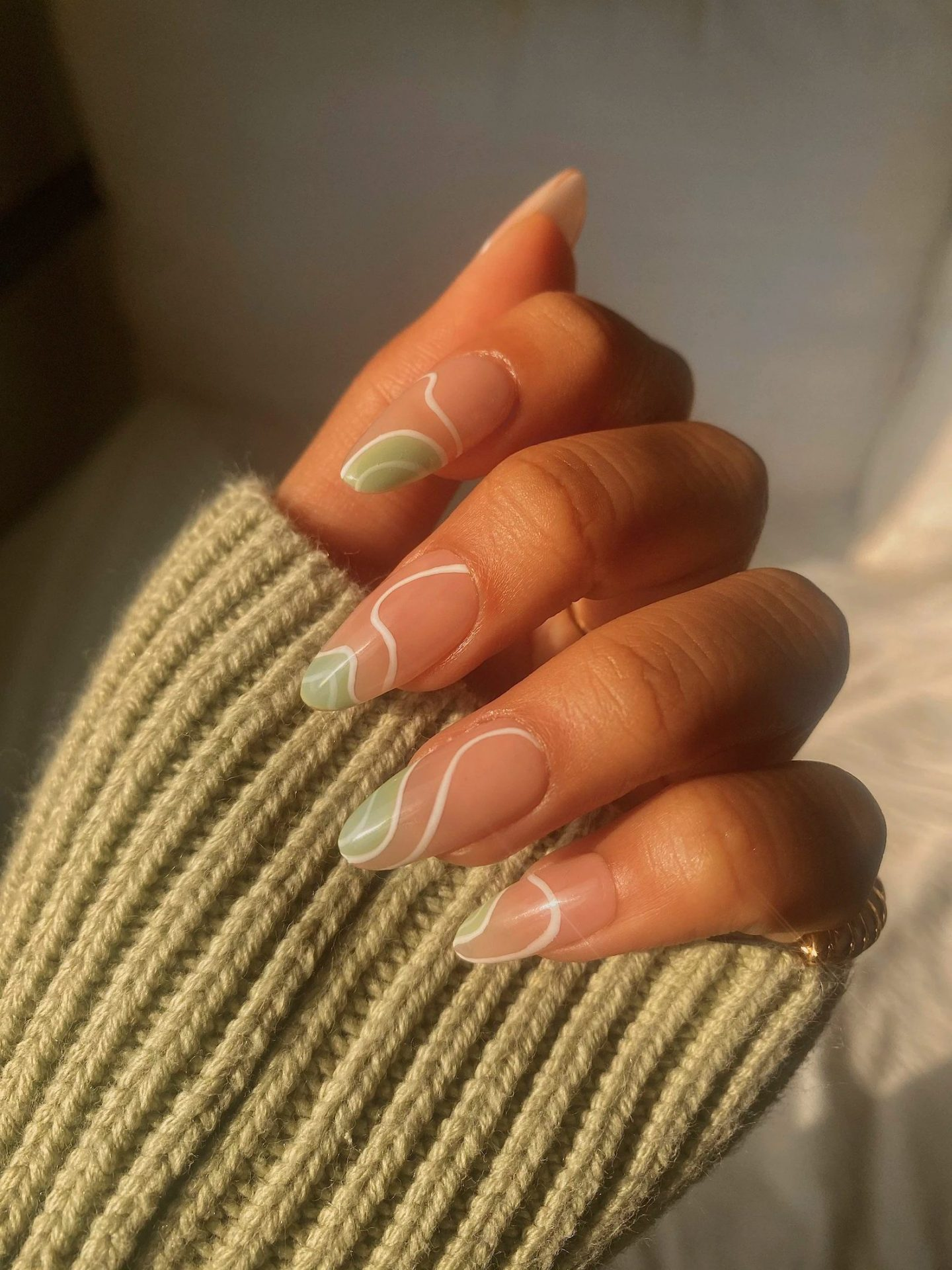 Cute abstract mint green nails in almond shape