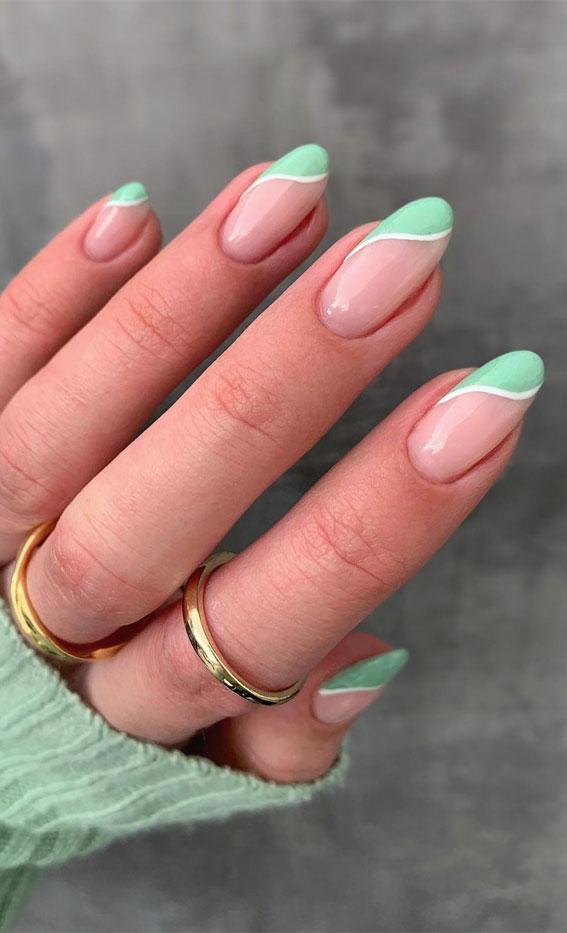 Cute mint green swirl nails in almond shape
