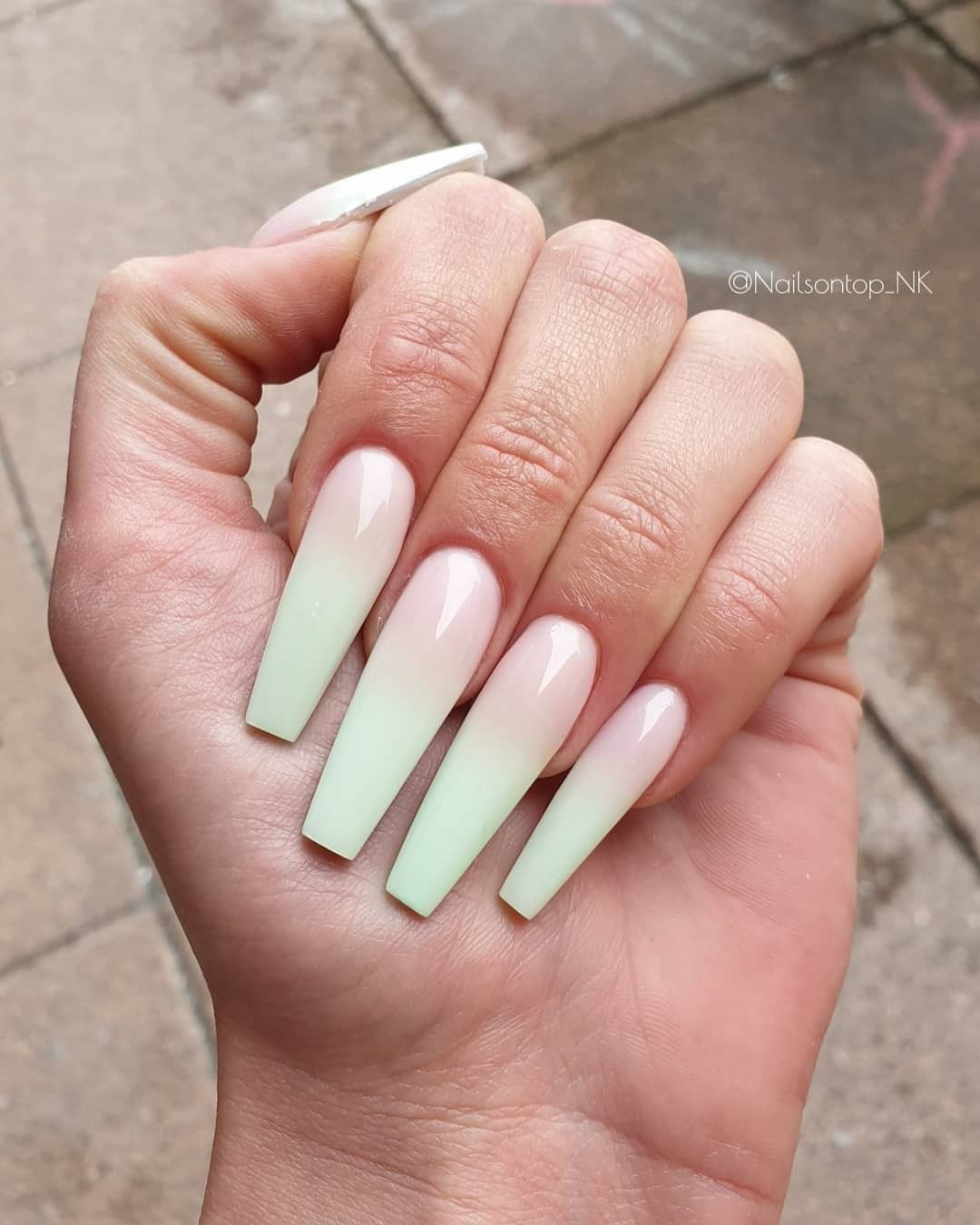Long light mint green ombre nails with French tip effect in coffin shape