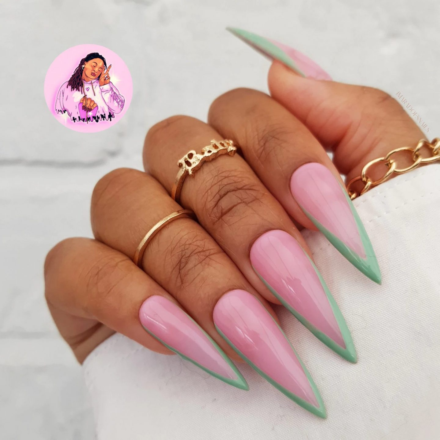 Mint green French tip nails in stiletto shape