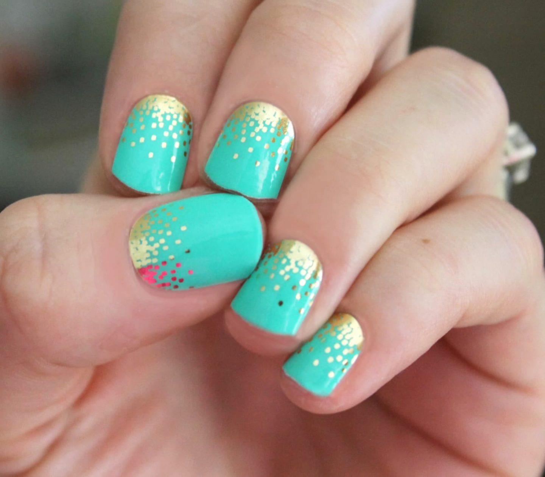 Short mint green nails with gold nail art