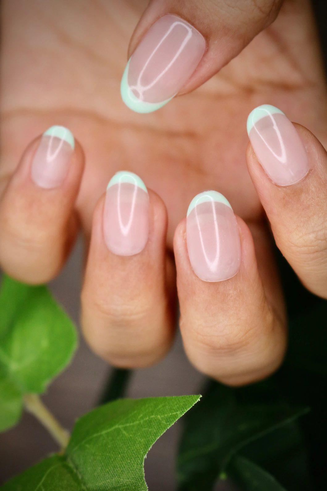 Minimalist mint green French tip nails
