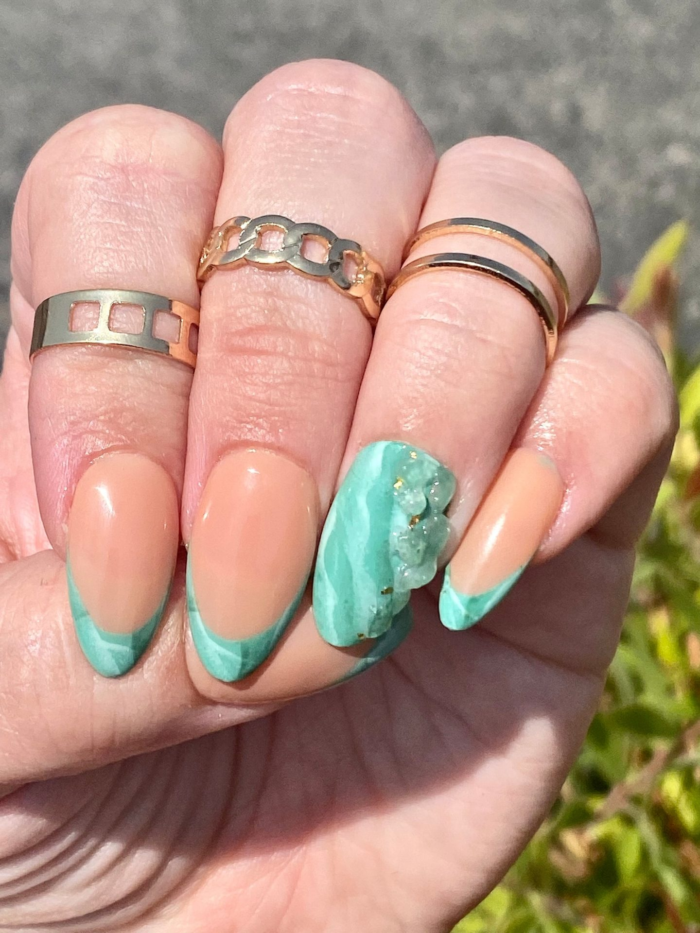 Cute turquoise French tip nails with marble nail art