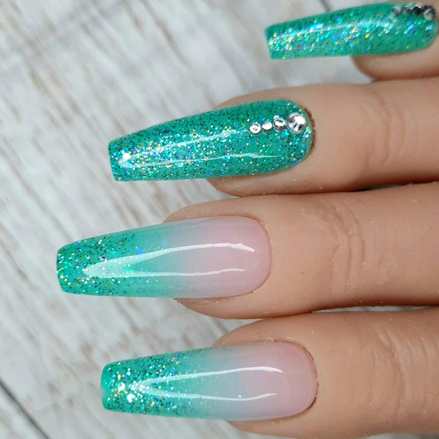 Long turquoise ombre nails with glitter