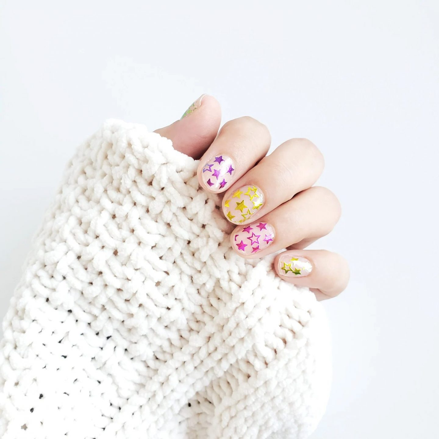 Cute New Years nails with colorful stars