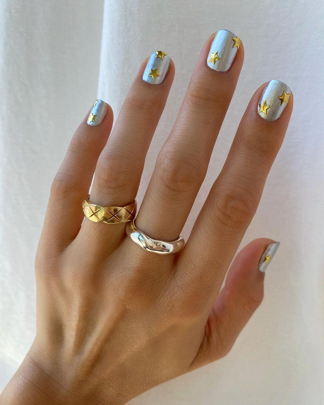 Cute short silver New Years nails with star nail art