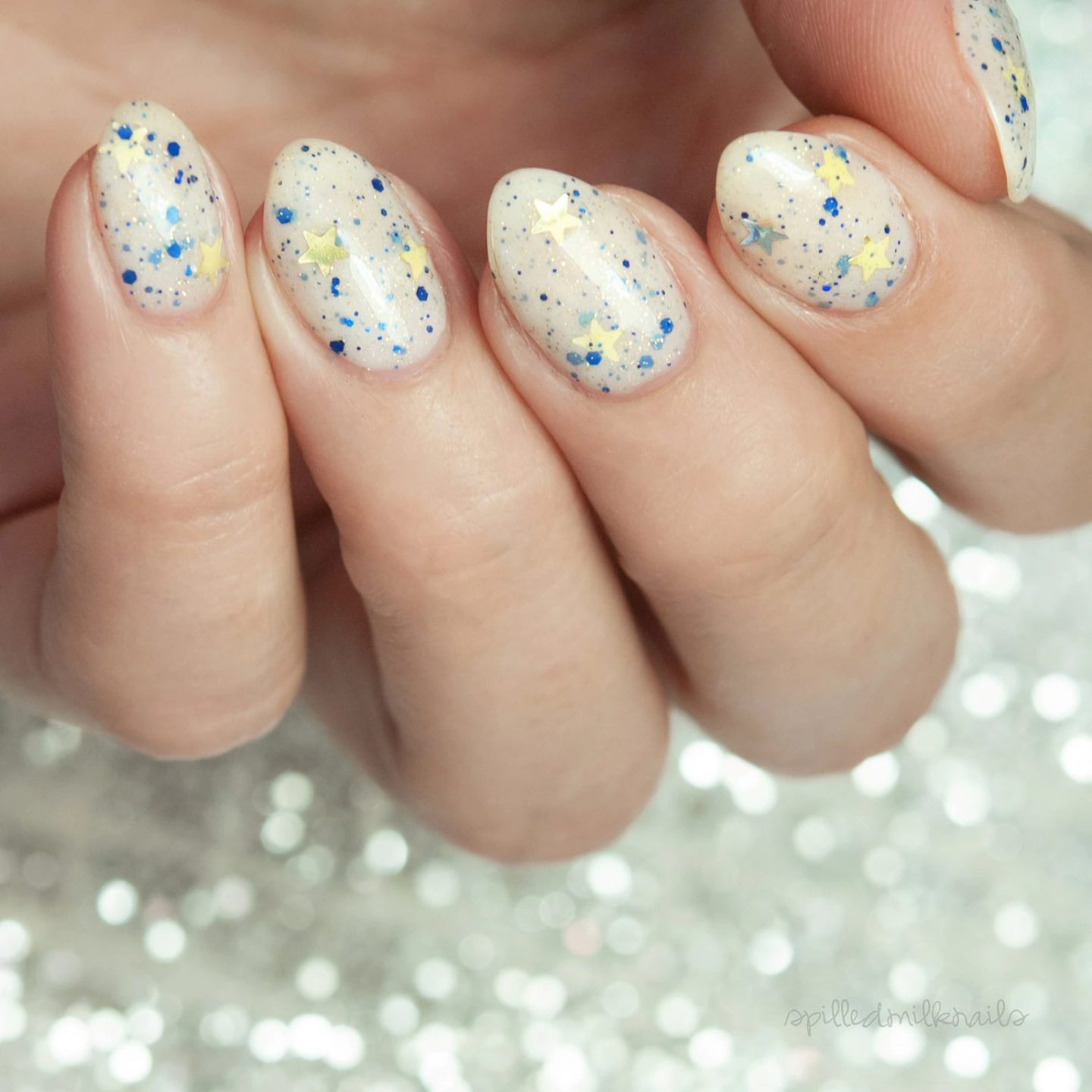 Cute short white New Years eve nails with stars and blue specks