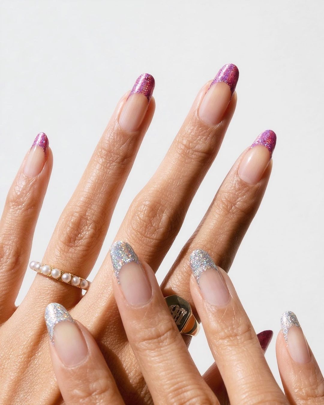 Cute silver and pink glitter French tip nails for New Years Eve