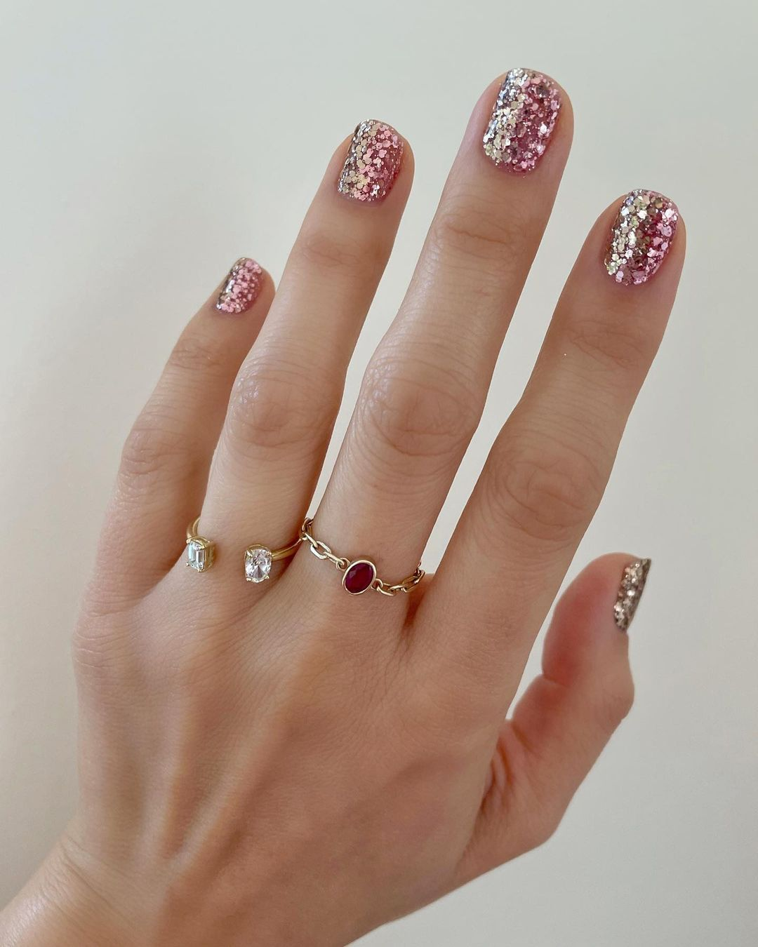 Short rose gold glitter nails for New Years Eve