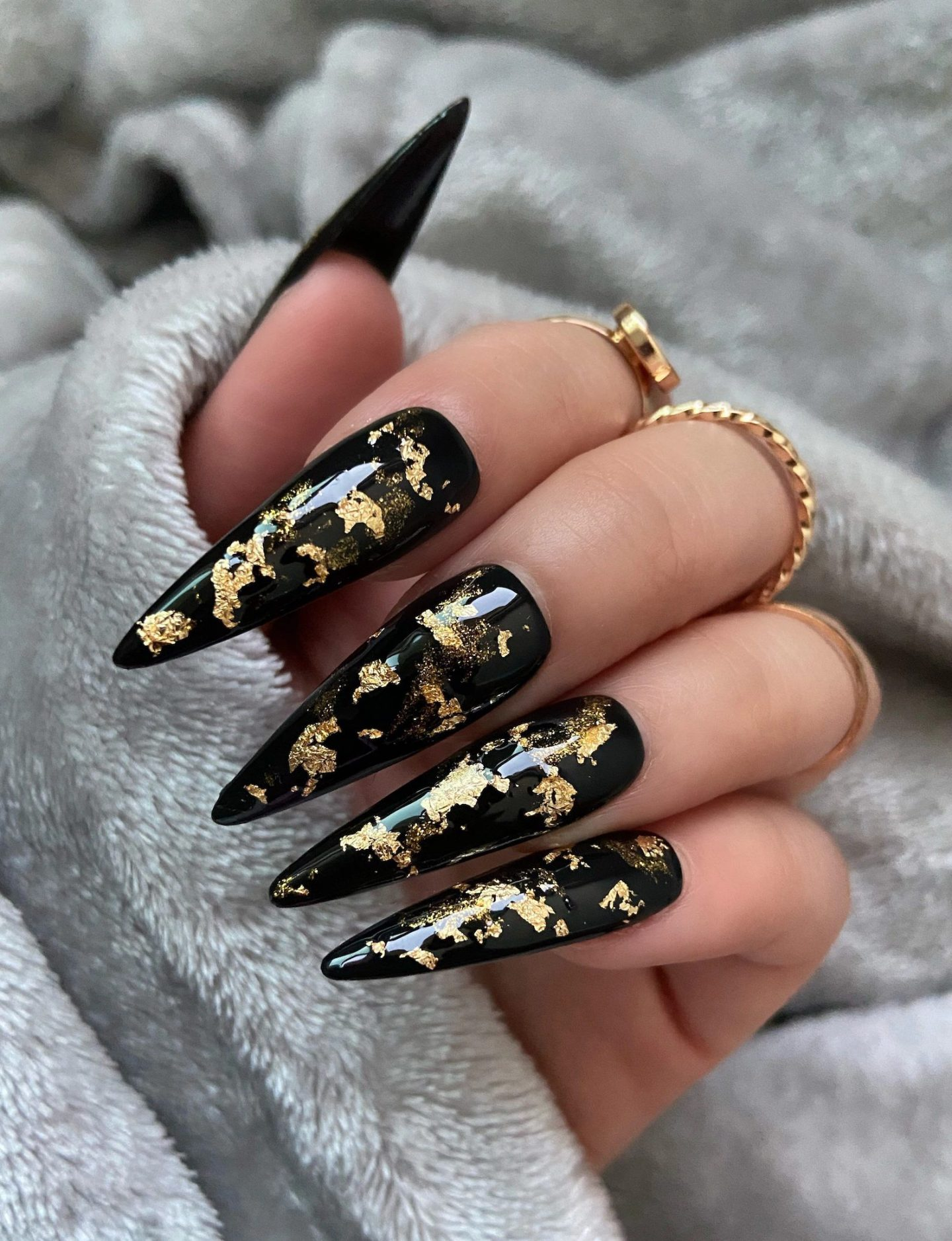 Cute long black stiletto nails with gold foil