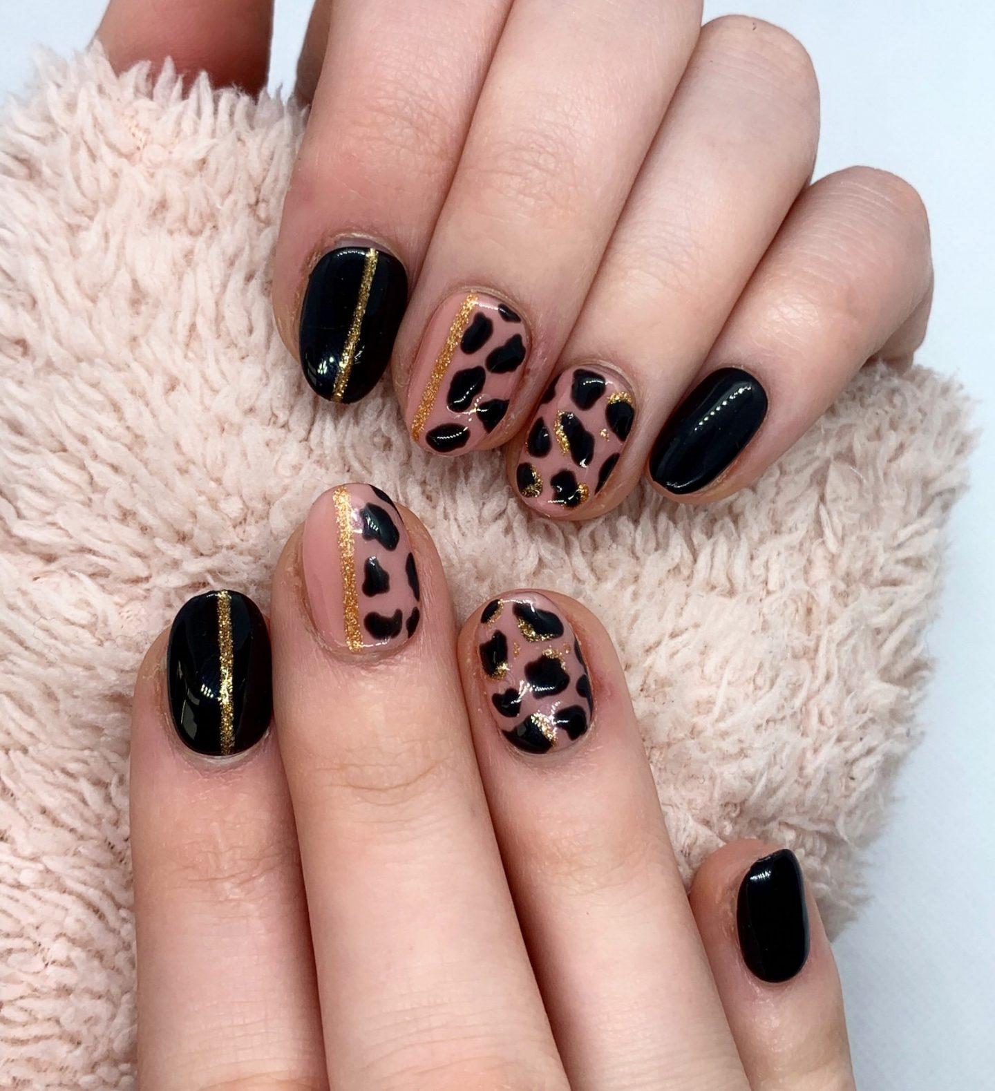 Cute short black and gold leopard print nails