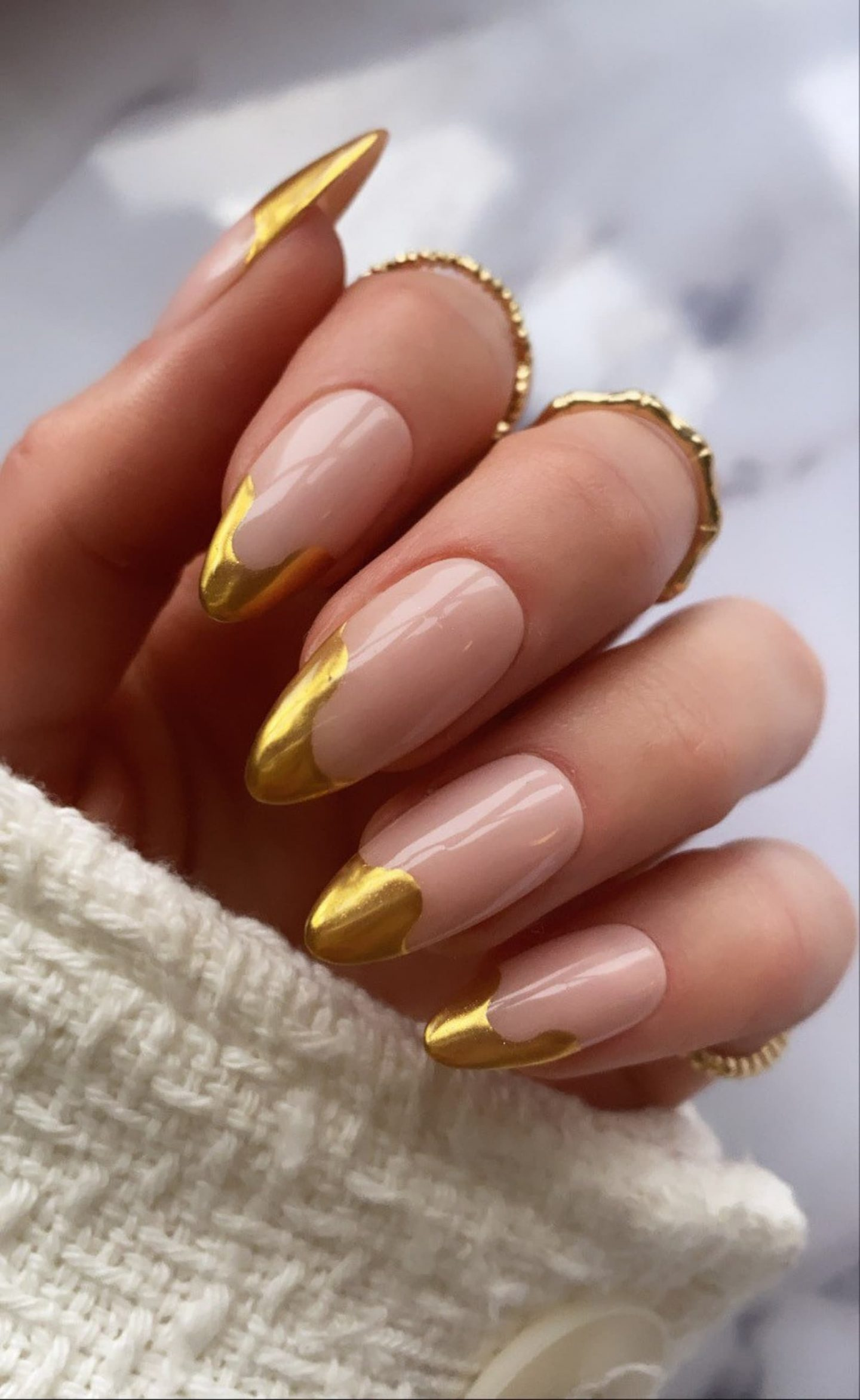 Gold French tip nails with swirl