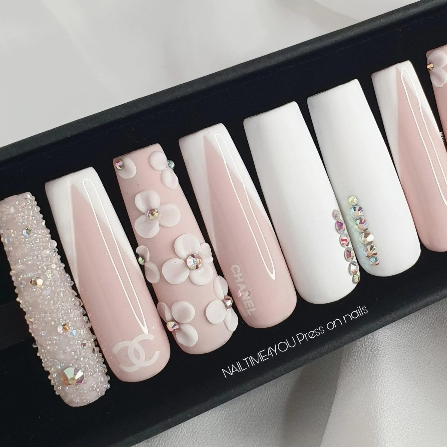 Cute light pink and white prom nails with crystals and flowers