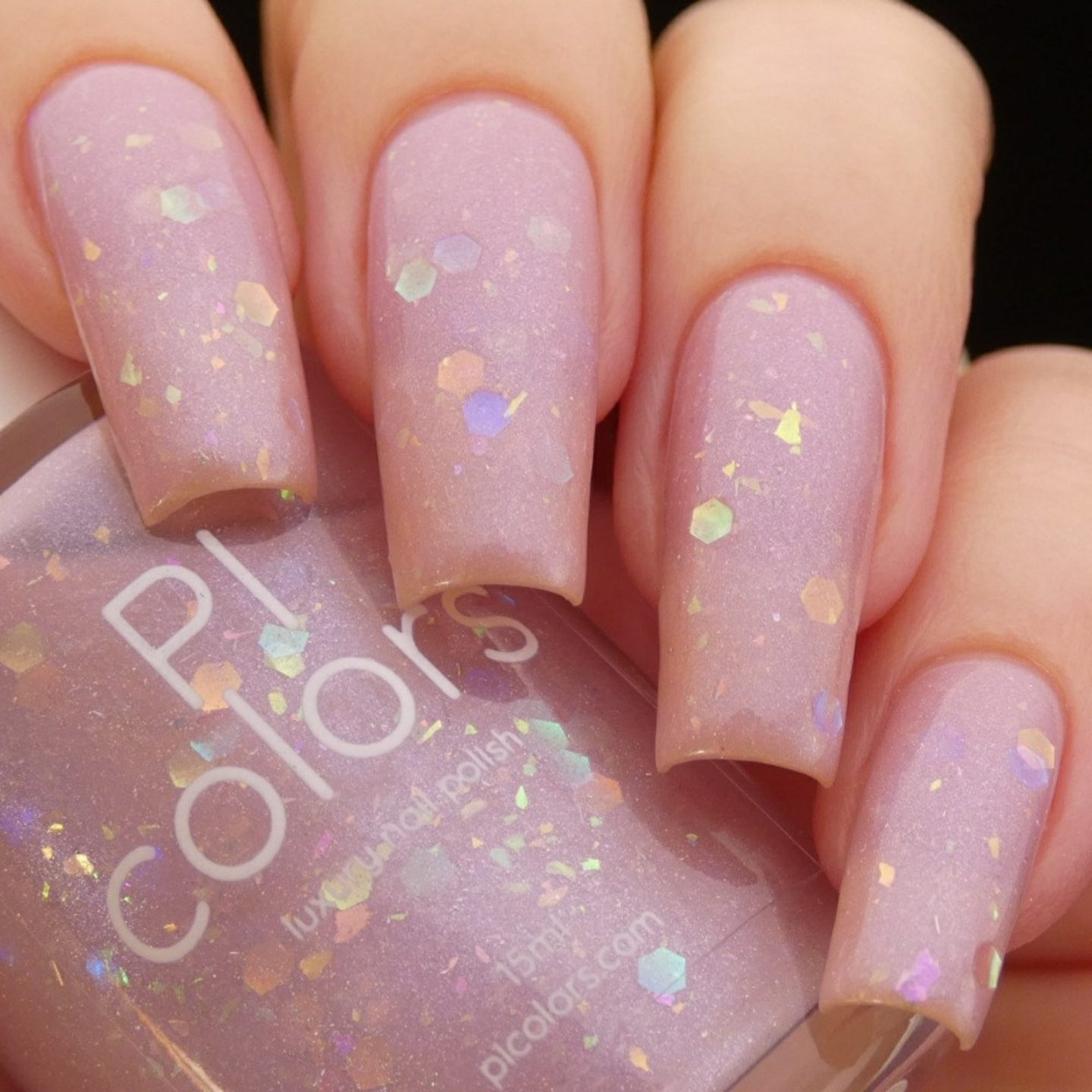 Long pale pink coffin nails with iridescent glitter