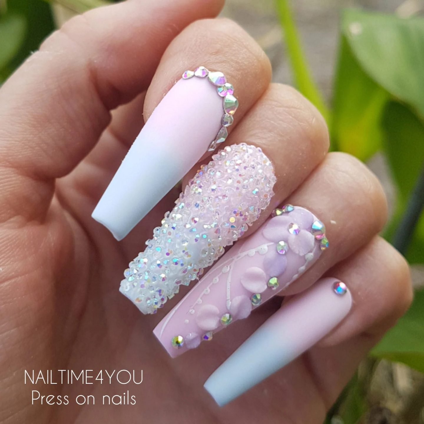 Cute pastel pink and blue ombre nails with crystals
