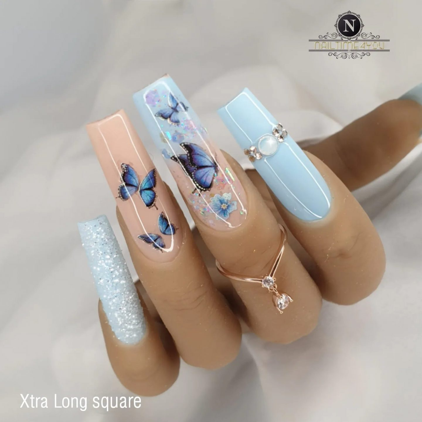 Cute long nude and baby blue butterfly nails