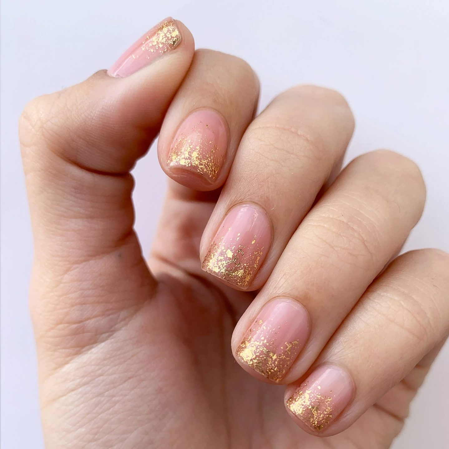 Cute and short gold glitter French tip nails